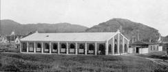 A/S Mandal Spikerfabrik sin første bygning. Bildet skal være fra 1917. Foto: Ukjent / Mandal Museum /DBVA.no<br>