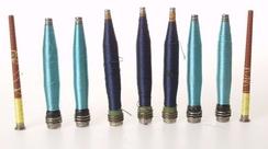 Spoler med viskosegarn brukt i Hjulas stoffer. NTM 21072