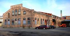 Helsfyr. Bygninger fra 1907 tilhørende Nittedals Tændstikfabrik. I 2010 bygges disse gamle bygningene inn i det nye skolekomplekset f21